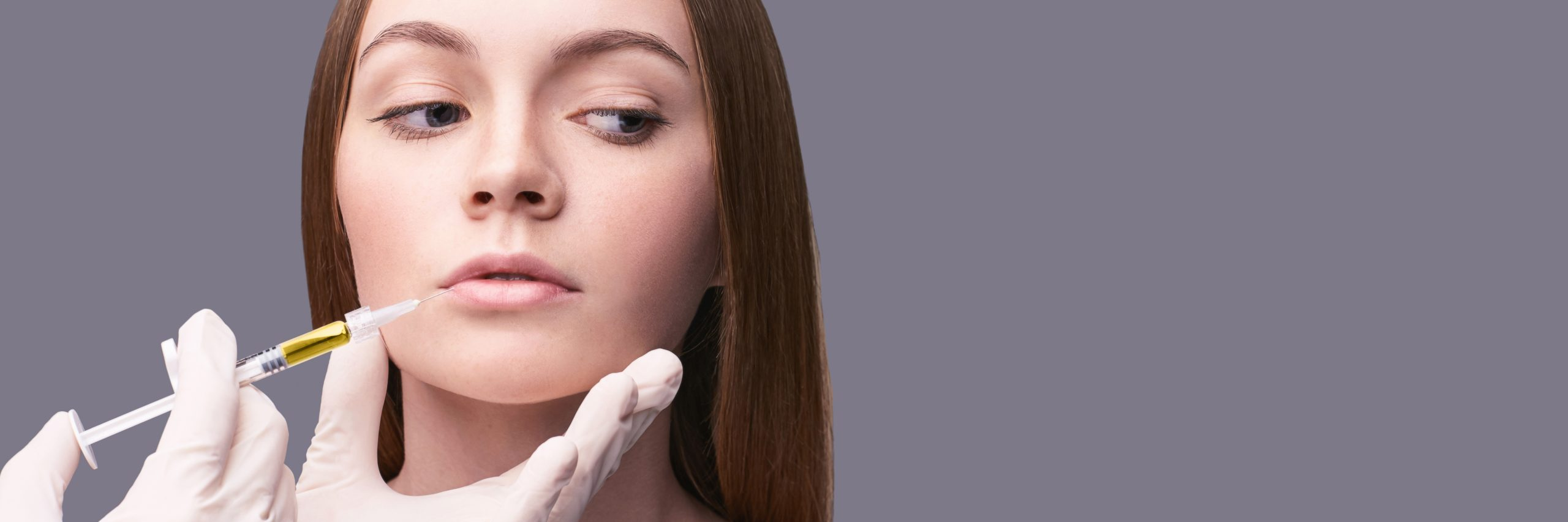 Closeup of rejuvenation lip. Beauty female face. Plastic surgery. Healthcare concept. Medical cosmetology, dermatology. Spa treatment. Hands in medicine gloves. Horizontal banner with copyspace